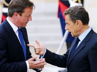 Despite a call for unity from the eurozone's unofficial leaders Merkel and Sarkozy, British Prime Minister David Cameron has vetoed their EU treaty, dividing opinion and possibly taking power away from London