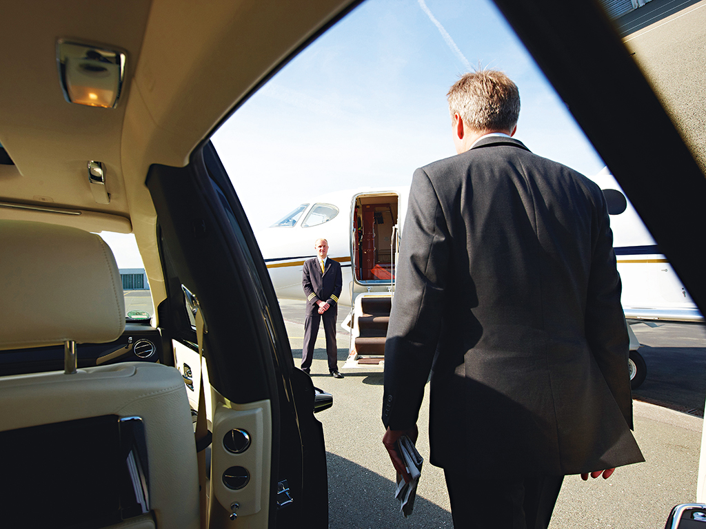 Businessmen steps out of a private jet