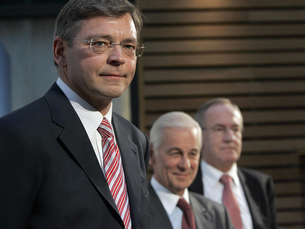 Clausen at a 2006 press conference announcing his appointment as CEO, with then bank President Hans Dalborg and the man he would soon replace, Lars G Norfström