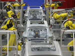 Robots working on the bodies of the new Porsche Macan in Leipzig, Germany. Cars are one of the countries biggest exports