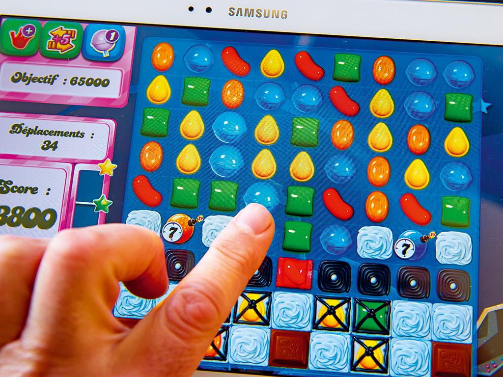 A tablet-user plays Candy Crush Saga