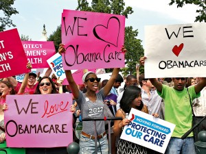 Obamacare supporters in Washington DC. Critics fear 43 million Americans will lose access to employer-based health insurance as a result of the system