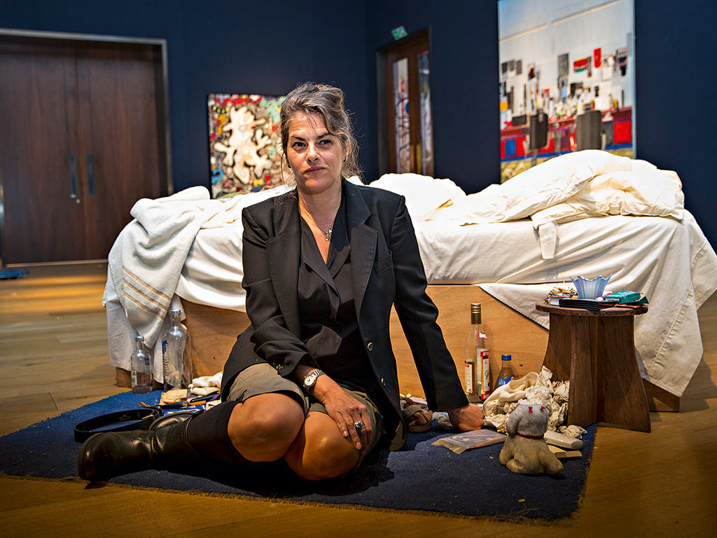 Tracey Emin in front of her notorious My Bed piece for the YBA exhibition