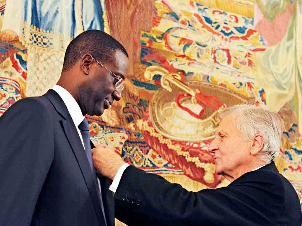 Tidjane Thiam being awarded with the French Legion of Honour by former European Central Bank president Jean-Claude Trichet
