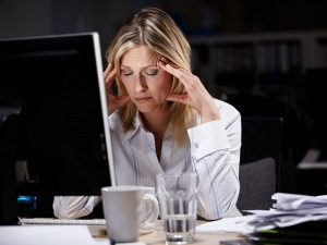 Symptoms of working too hard include gastric upsets, difficulty sleeping and forgetting information easily