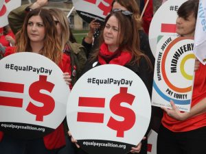Women rally on the US' Equal Pay Day to demand an end to the gender pay gap. In 2017, women in the US earned 82% of what men did