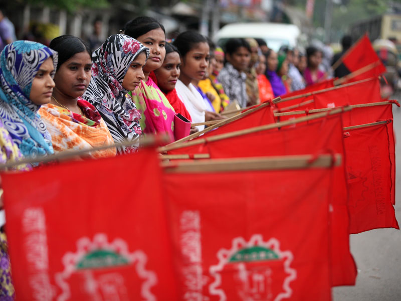 Bangladeshi garment workers protest for better wages and compensation for victims of the Rana Plaza factory collapse