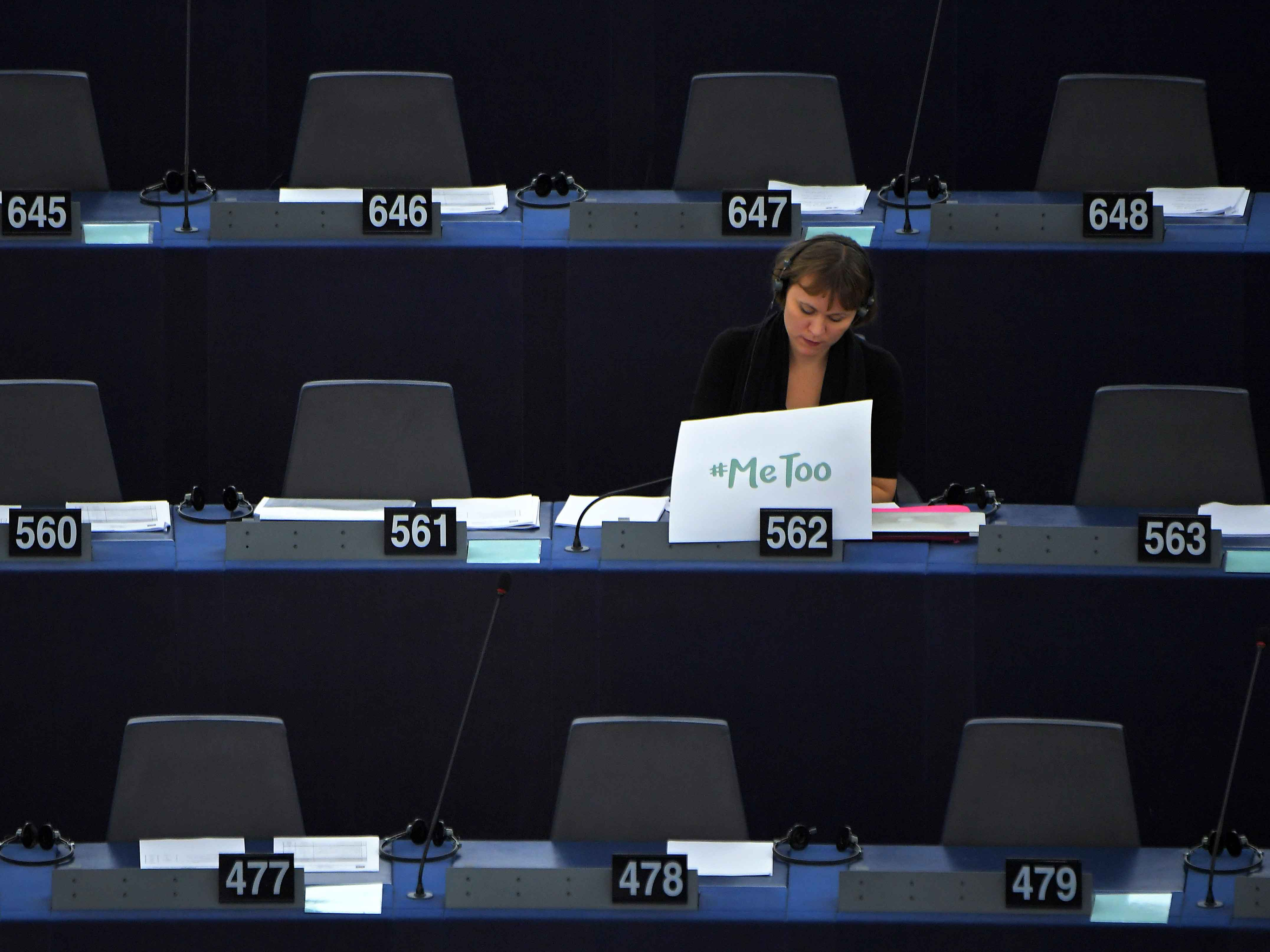 Swedish MEP Linnéa Engström displays a #MeToo placard at the European Parliament during a debate about combating sexual harassment and abuse in the EU