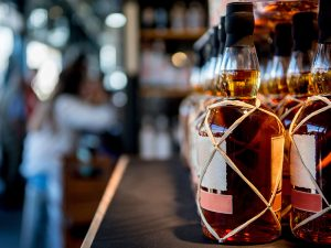 The US has decided against a tariff increase, but custom duties imposed on items such as whisky remain in place, angering trade bodies
